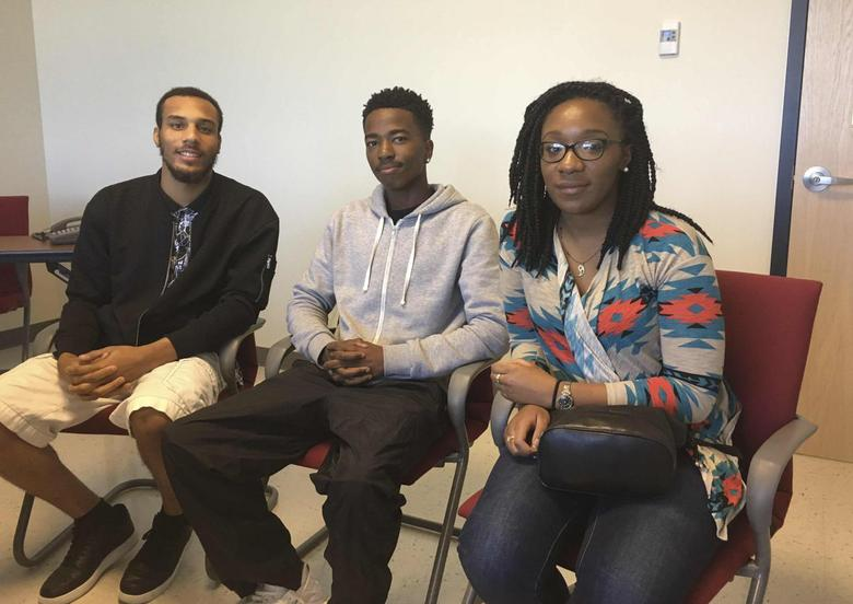 Joshua Goodson, 23, Mark Morris, 17, and Sydney Roy, 20, (L to R) are seen during an interview at the Family & Workforce Centers of America in Wellston, Missouri, U.S. September 27, 2016.   REUTERS/Howard Schneider/File photo