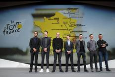 From L-R, riders Thibaut Pinot of France, Romain Bardet of France, Chris Froome of Britain, Richie Porte of Australia, Julian Alaphilippe of France, Tony Martin of Germany, Thomas Voeckler of France pose after the presentation of the itinerary of the 2017 Tour de France cycling race at a news conference in Paris, France, October 18, 2016. REUTERS/Benoit Tessier