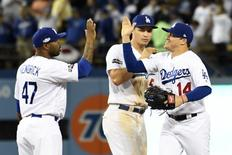Oct 18, 2016; Los Angeles, CA, USA; Los Angeles Dodgers left fielder Enrique Hernandez (14) celebrates with left fielder Howie Kendrick (47) after beating the Chicago Cubs in game three of the 2016 NLCS playoff baseball series at Dodger Stadium. Mandatory Credit: Richard Mackson-USA TODAY Sports