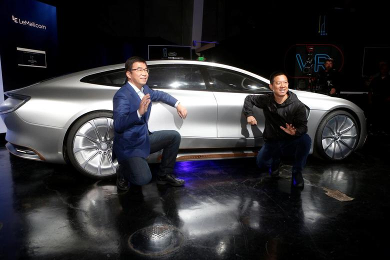 LeEco CEO and founder YT Jia, R, and co-founder and Global Vice Chairman Lei Ding pose in front of a LeSEE car during a press event in San Francisco, California, U.S. October 19, 2016.  RETUERS/Beck Diefenbach
