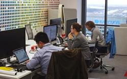 """UBS employees work in the UBS """"fintech lab"""" at Canary Wharf in London, Britain, October 19, 2016. REUTERS/Hannah McKay"""