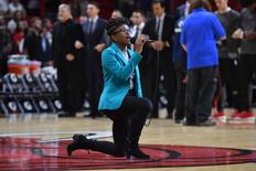 Oct 21, 2016; Miami, FL, USA; National Anthem singer Denasia Lawrence kneels as she sings the anthem prior to the game between the Miami Heat and the Philadelphia 76ers at American Airlines Arena. Mandatory Credit: Jasen Vinlove-USA TODAY Sports