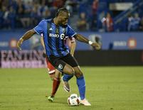 Sep 17, 2016; Montreal, Quebec, CAN; Montreal Impact forward Didier Drogba (11) dribbles the ball during the second half against the New England Revolution at Stade Saputo. Mandatory Credit: Eric Bolte-USA TODAY Sports