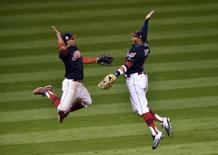 Oct 25, 2016; Cleveland, OH, USA; Cleveland Indians shortstop Francisco Lindor (12) celebrates with center fielder Rajai Davis (20) after defeating the Chicago Cubs in game one of the 2016 World Series at Progressive Field. Mandatory Credit: David Richard-USA TODAY Sports - RTX2QGFR