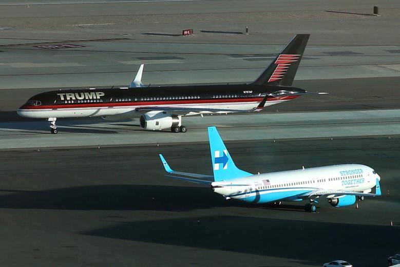 Donald Trump's campaign plane passes Hillary Clinton's campaign plane as it lands in Las Vegas, Nevada, October 18, 2016. REUTERS/Lucy Nicholson