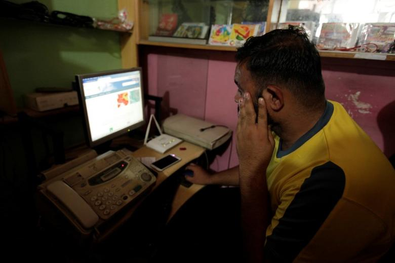 A man explores social media on a computer at an internet club in Islamabad, Pakistan, August 11, 2016. Picture taken August 11, 2016. REUTERS/Faisal Mahmood