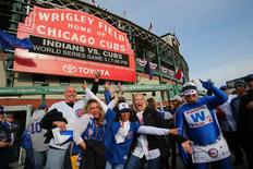 Chicago Cubs fans pose in front of Wrigley Field before game three of the 2016 World Series between the Chicago Cubs and the Cleveland Indians, in Chicago, Illinois, October 28, 2016. Mandatory Credit: Jerry Lai-USA TODAY Sports