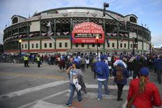Oct 30, 2016; Chicago, IL, USA; Fans walk in front of Wrigley Field before game four of the 2016 World Series between the Chicago Cubs and the Cleveland Indians. Mandatory Credit: Jerry Lai-USA TODAY Sports