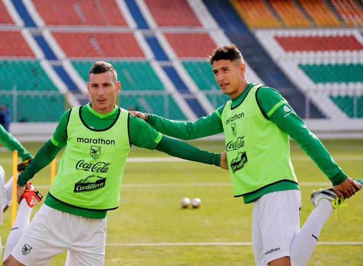 ca8ba23bc Pablo Escobar (L) and Nelson Cabrera of Bolivia s national soccer team  stretch during a training session ahead ...
