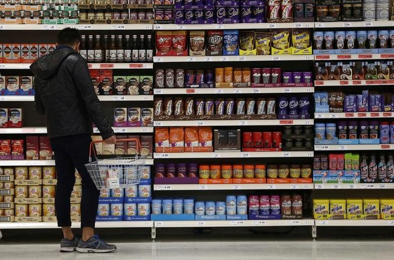 A shopper browses items at a Sainsbury's store in London, Britain, October 11, 2016. REUTERS/Neil Hall/File Photo - RTSS1WZ