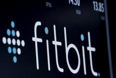 The ticker symbol for Fitbit is displayed at the post where it is traded on the floor of the New York Stock Exchange (NYSE) February 23, 2016. REUTERS/Brendan McDermid  - RTX287KH