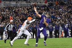 Nov 10, 2016; Baltimore, MD, USA;  Baltimore Ravens quarterback Joe Flacco (5) throws as Cleveland Browns inside linebacker Demario Davis (56) applies pressure during the second quarter at M&T Bank Stadium. Mandatory Credit: Tommy Gilligan-USA TODAY Sports