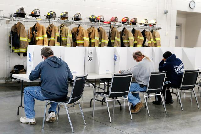 Voters fill out their ballots at Elevation Fire Station in Benson, North Carolina. REUTERS/Chris Keane