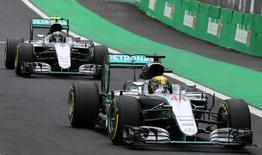 Formula One - F1 - Brazilian Grand Prix - Circuit of Interlagos, Sao Paulo, Brazil - 12/11/2016 - Mercedes' drivers Lewis Hamilton of Britain (44) and Nico Rosberg (6) of Germany drive during the qualifying session.    REUTERS/Paulo Whitaker