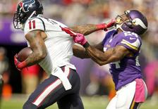 Oct 9, 2016; Minneapolis, MN, USA; Houston Texans wide receiver Jaelen Strong (11) catches a pass and tries to strong arm Minnesota Vikings cornerback Captain Munnerlyn (24) in the second quarter at U.S. Bank Stadium. The Vikings win 31-13. Mandatory Credit: Bruce Kluckhohn-USA TODAY Sports