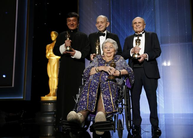 Honorary Award winners Jackie Chan, Frederick Wiseman, Anne V. Coates and Lynn Stalmaster pose on stage at the 8th Annual Governors Awards in Los Angeles.