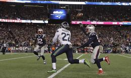 Nov 13, 2016; Foxborough, MA, USA; Seattle Seahawks running back C.J. Prosise (22) makes the catch against New England Patriots outside linebacker Elandon Roberts (52) and free safety Devin McCourty (32) in the second half at Gillette Stadium. Seattle Seahawks defeated the Patriots 31-24. Mandatory Credit: David Butler II-USA TODAY Sports