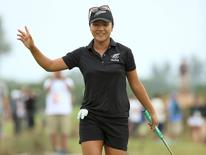 2016 Rio Olympics - Golf - Final - Women's Individual Stroke Play - Olympic Golf Course - Rio de Janeiro, Brazil - 20/08/2016. Lydia Ko (NZL) of New Zealand reacts after a birdie putt on the 18th green during final round women's Olympic golf competition.     REUTERS/Kevin Lamarque