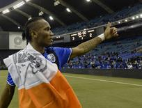 Nov 22, 2016; Montreal, Quebec, CAN; Montreal Impact forward Didier Drogba (11) interacts with fans after the first leg game against the Toronto FC of the MLS Eastern Conference Championship at Olympic Stadium.  Eric Bolte-USA TODAY Sports