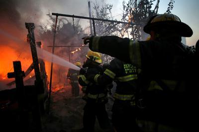 Massive wildfires tear across Israel