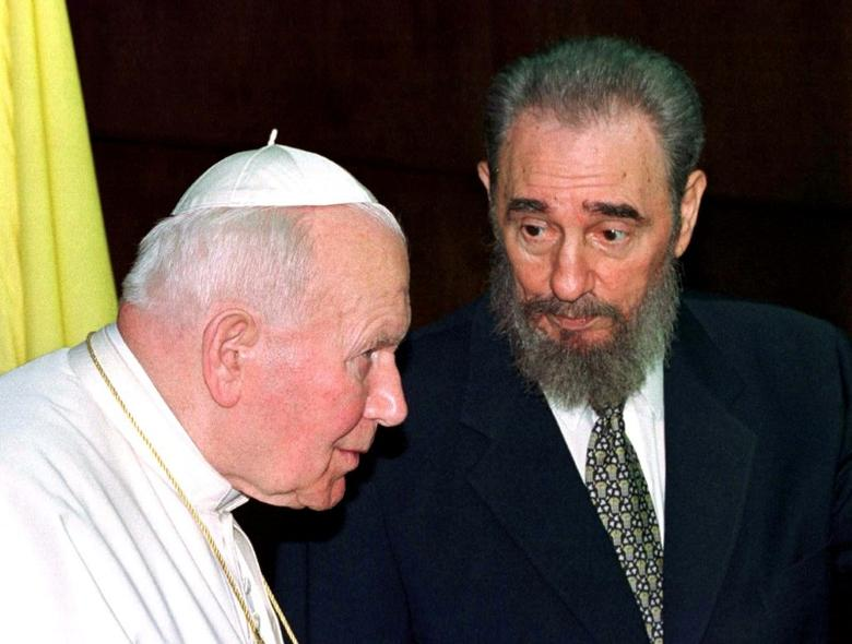 Then Cuban President Fidel Castro talks to then Pope John Paul II during the presentation of their delegations at the Palace of the Revolution in Havana in this January 22, 1998 file photo. REUTERS/Paul Hanna/File Photo
