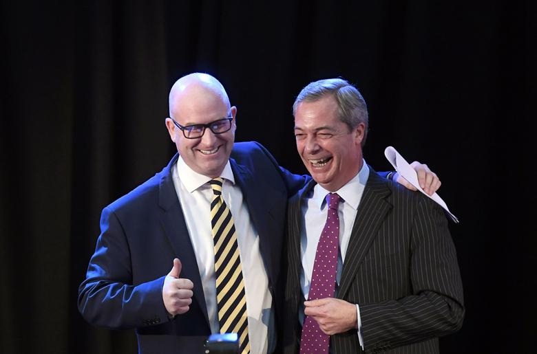United Kingdom Independence Party (UKIP) interim leader Nigel Farage (R) embraces newly elected leader Paul Nuttall, in London, Britain November 28, 2016. REUTERS/Toby Melville