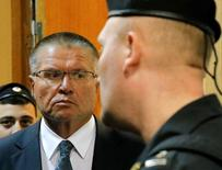 File photo of then Russian Economy Minister Alexei Ulyukayev who was detained by law enforcement officials on corruption charges, is escorted upon his arrival for a hearing at the Basmanny district court in Moscow, Russia, November 15, 2016.    REUTERS/Maxim Zmeyev