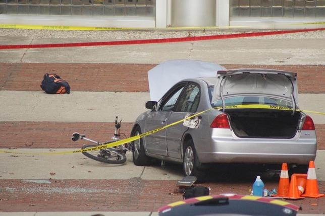 A car which police say was used by an attacker to plow into a group of students is seen outside Watts Hall on Ohio State University's campus in Columbus, Ohio. Courtesy of Mason Swires/thelantern.com/Handout via REUTERS