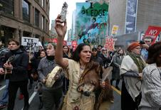 St'at'imc bear dancer Jackie Andrew of Lil'wat First Nation burns sage during a protest march against the proposed expansion of Kinder Morgan's Trans Mountain Pipeline in Vancouver, British Columbia, Canada. REUTERS/Chris Helgren