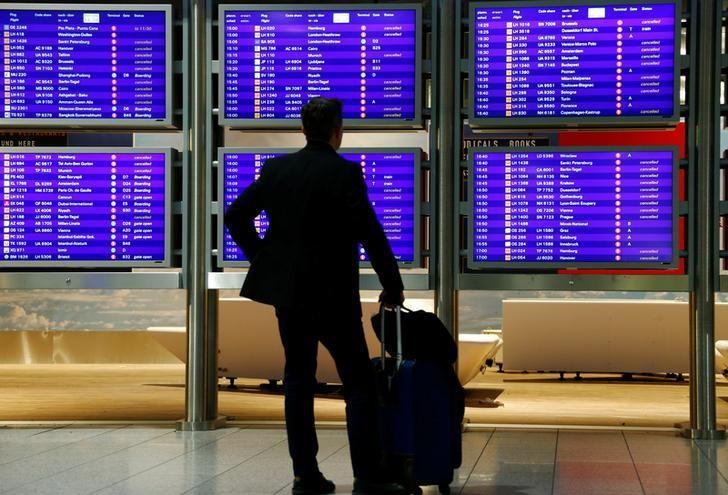 A passenger informs himself during a pilots strike of the German airline Lufthansa at Frankfurt airport, Germany November 29, 2016. REUTERS/Ralph Orlowski