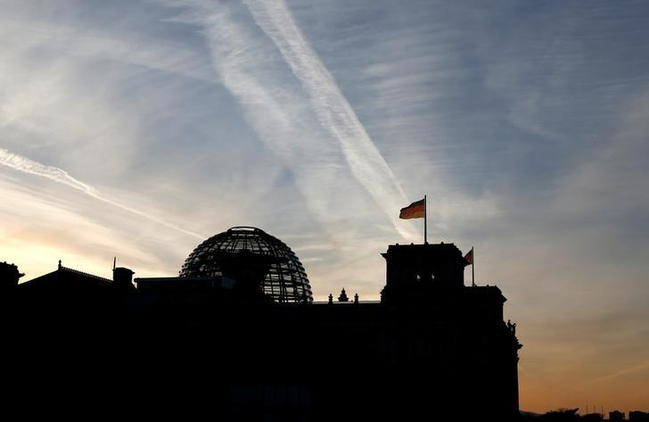 The Reichstag building is silhouetted during sunset in Berlin, Germany, November 24, 2016.   REUTERS/Fabrizio Bensch