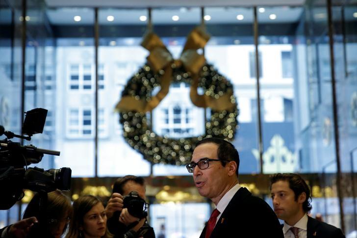 Steven Mnuchin, U.S. President-elect Donald Trump's reported choice for U.S. Treasury Secretary, speaks to members of the news media upon his arrival at Trump Tower in New York, U.S. November 30, 2016.   REUTERS/Mike Segar
