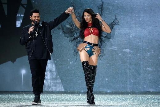 Musician The Weeknd performs with model Adriana Lima. REUTERS/Charles Platiau