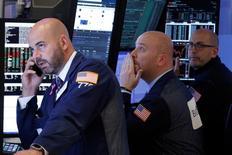 Traders work on the floor of the New York Stock Exchange (NYSE) in New York City, U.S., November 22, 2016.  REUTERS/Brendan McDermid