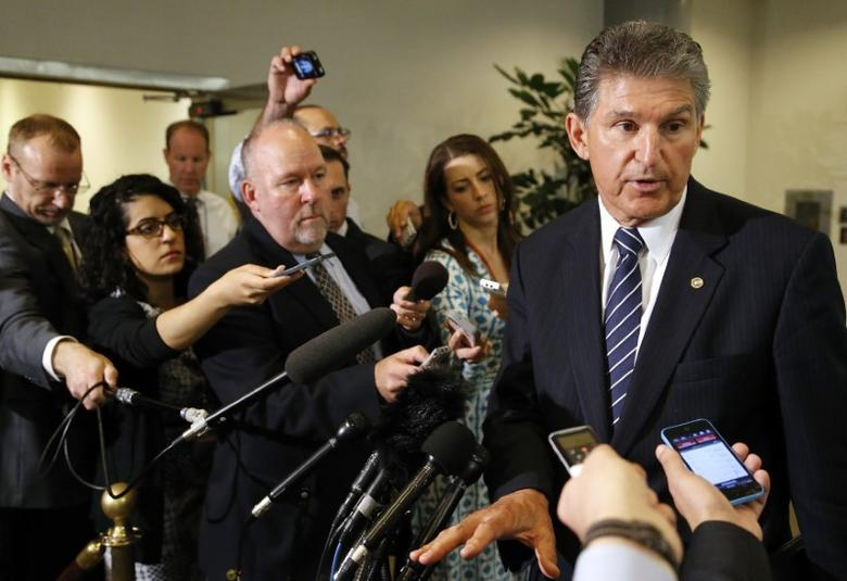 U.S. Senator Joe Manchin (D-WV) (R) talks to reporters outside of a closed-door Senate Armed Services Committee briefing on the Bergdahl prisoner swap at the U.S. Capitolin Washington June 10, 2014.  REUTERS/Jonathan Ernst
