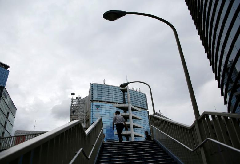 A man climbs the stairs to a bridge at a commercial district in Tokyo, Japan, September 8, 2016.  REUTERS/Kim Kyung-Hoon