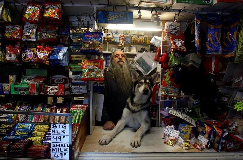 William Mulhall poses for a photograph in his old curiosity shop in the small seaside village of Ardglass in Co.Down January 15, 2012.   REUTERS/Cathal McNaughton/File Photo