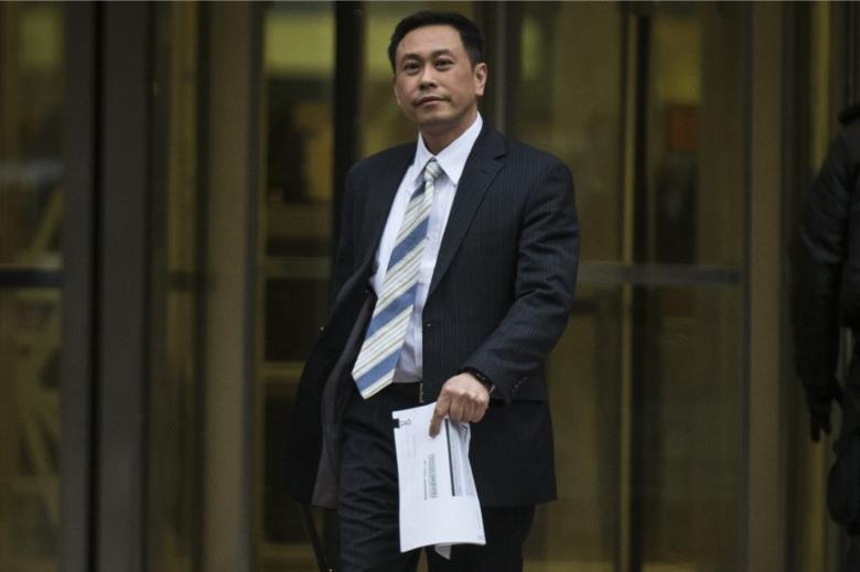 Wing Chau exits the Jacob Javits Federal building in New York April 7, 2014.   REUTERS/Brendan McDermid