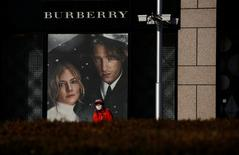 A woman walks past a boutique of the Burberry luxury goods company in Beijing, China, December 1, 2016.  REUTERS/Thomas Peter