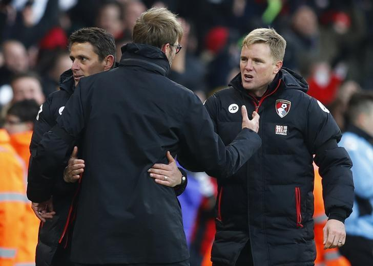 Football Soccer Britain - AFC Bournemouth v Liverpool - Premier League - Vitality Stadium - 4/12/16 Bournemouth manager Eddie Howe and assistant Jason Tindall shake hands with Liverpool manager Juergen Klopp  after the game  Reuters / Eddie Keogh Livepic