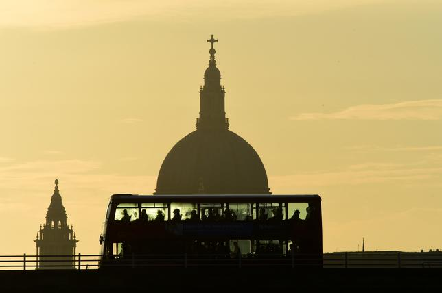 A bus carries commuters as it travels over Waterloo Bridge in London, Britain June 24, 2016.  REUTERS/Toby Melville/File Photo