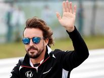 Formula One - Japanese Grand Prix - Suzuka Circuit, Japan- 9/10/16.  Fernando Alonso of Spain attends the drivers parade. REUTERS/Toru Hanai