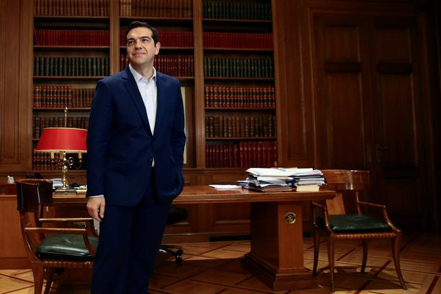 Greek Prime Minister Alexis Tsipras waits for German Foreign Minister Frank-Walter Steinmeier at his office in Maximos Mansion in Athens, Greece, December 5, 2016. REUTERS/Alkis Konstantinidis