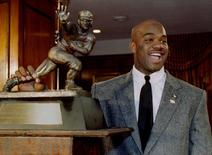Colorado tailback Rashaan Salaam, stands with the Heisman Trophy, College Football's highest award, after being named the outstanding college football player of 1994 at the Downtown Athletic Club in New York, U.S. on December 10, 1994.    REUTERS/Mike Segar/File Photo