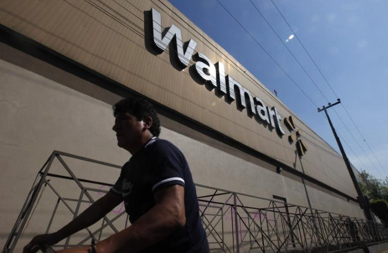 A person walks outside a Wal-Mart store in Mexico City January 11, 2013. REUTERS/Edgard Garrido