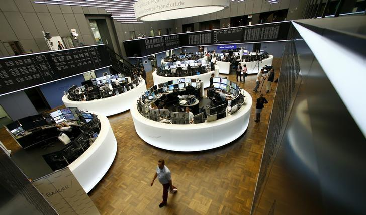 Traders work at their desks in front of the German share price index, DAX board, at the stock exchange in Frankfurt, Germany, June 24, 2016. REUTERS/Ralph Orlowski/Files