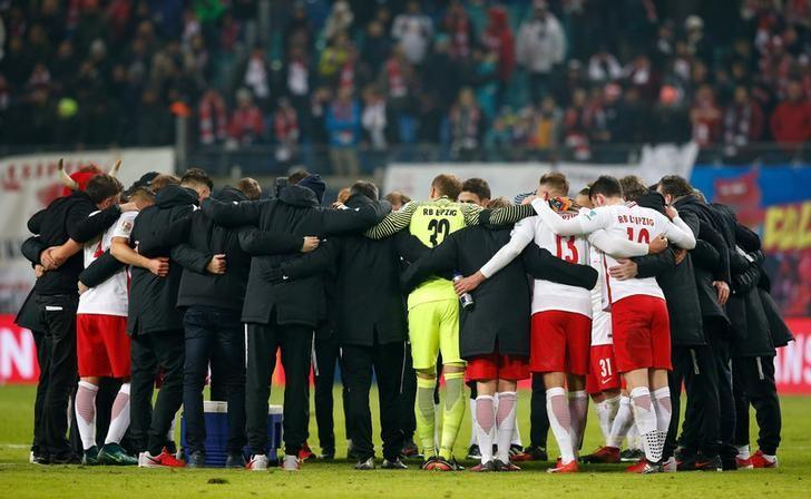 Football Soccer - RB Leipzig v - FC Schalke 04 - German Bundesliga - Red Bull Arena, Leipzig, Germany - 03/12/16 - RB Leipzig's players and staff celebrate after winning the match.   REUTERS/Fabrizio Bensch/Files