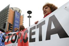 Demonstrators protest against the Comprehensive Economic and Trade Agreement CETA, a planned EU-Canada free trade agreement, outside the European Commission headquarters in Brussels, Belgium, October 27, 2016.    REUTERS/Yves Herman