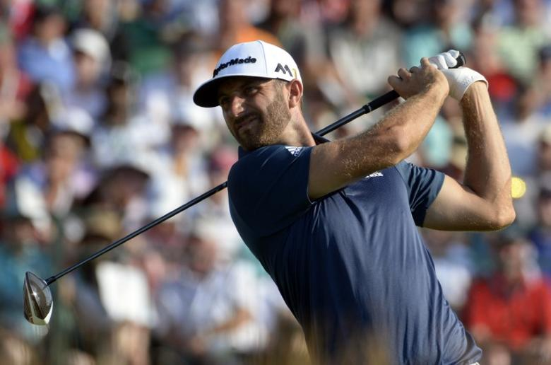 Jun 19, 2016; Oakmont, PA, USA; Dustin Johnson hits his tee shot on the 12th hole during the final round of the U.S. Open golf tournament at Oakmont Country Club. Mandatory Credit: Michael Madrid-USA TODAY Sports