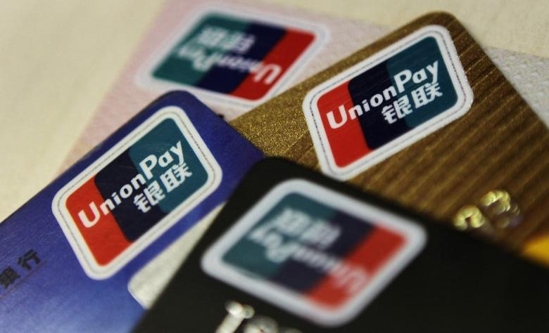 Logos of China UnionPay are seen on bank cards in this photo illustration taken in Beijing December 5, 2013. Picture taken December 5, 2013.   REUTERS/Barry Huang